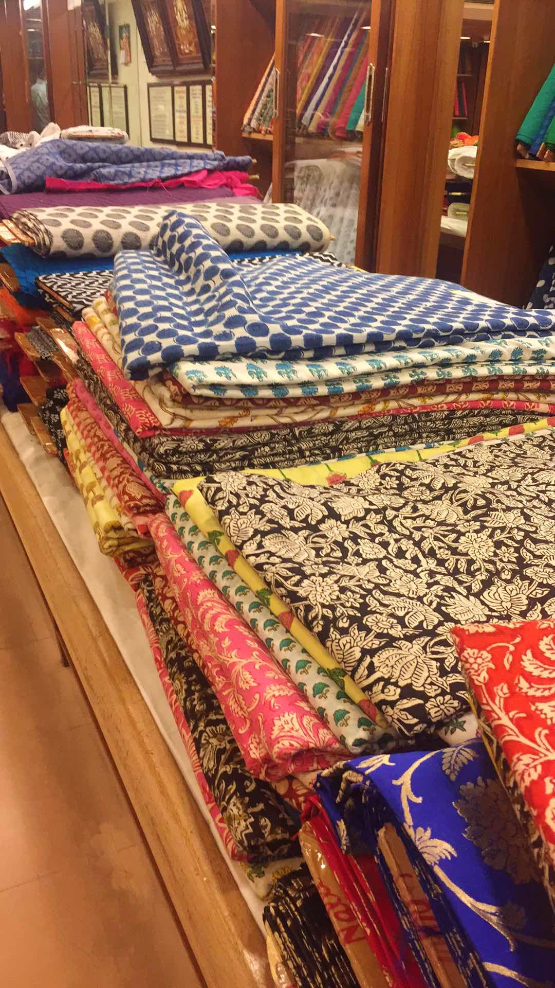 Textile,Bed sheet,Room,Quilting,Woven fabric,Quilt,Linens,Furniture,Carpet,Flooring