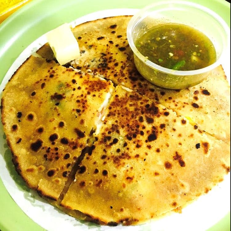Get Cheesy Pizza Parathas At This Joint, With Amazing Green Chutney