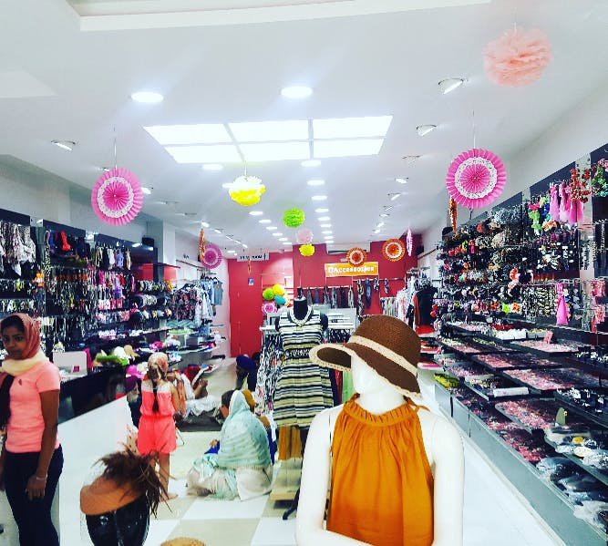 Outlet store,Product,Footwear,Pink,Yellow,Fashion,Building,Retail,Interior design,Shopping mall