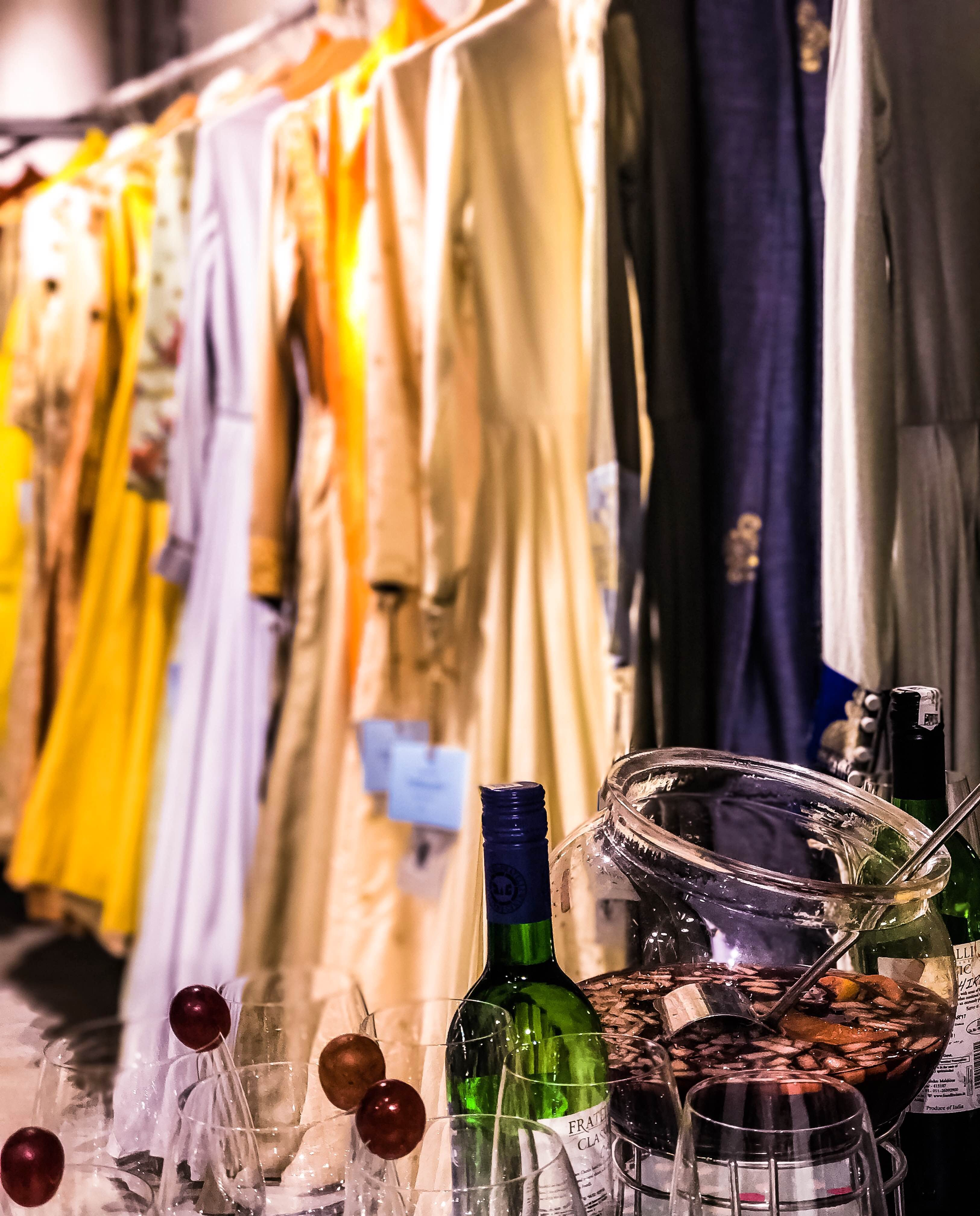 Yellow,Room,Textile,Stemware,Glass,Glass bottle,Drink,Wine glass,Dress,Curtain