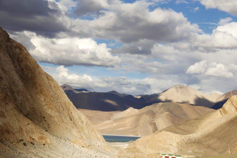 Mountainous landforms,Badlands,Sky,Formation,Cloud,Geology,Mountain,Wadi,Rock,Hill