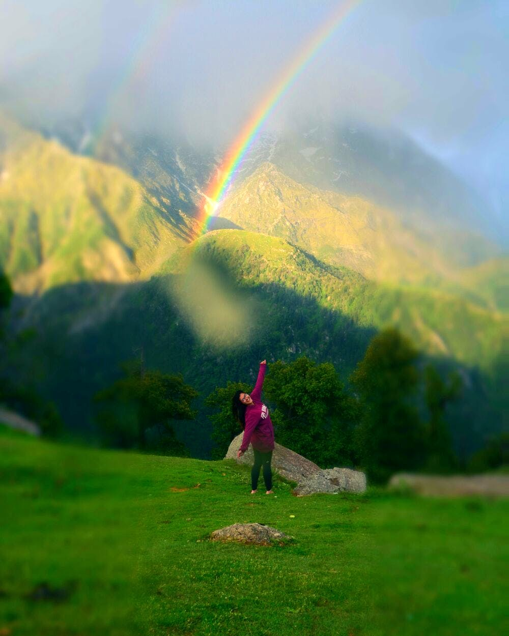 Rainbow,People in nature,Highland,Nature,Sky,Mountainous landforms,Green,Hill,Grassland,Mountain