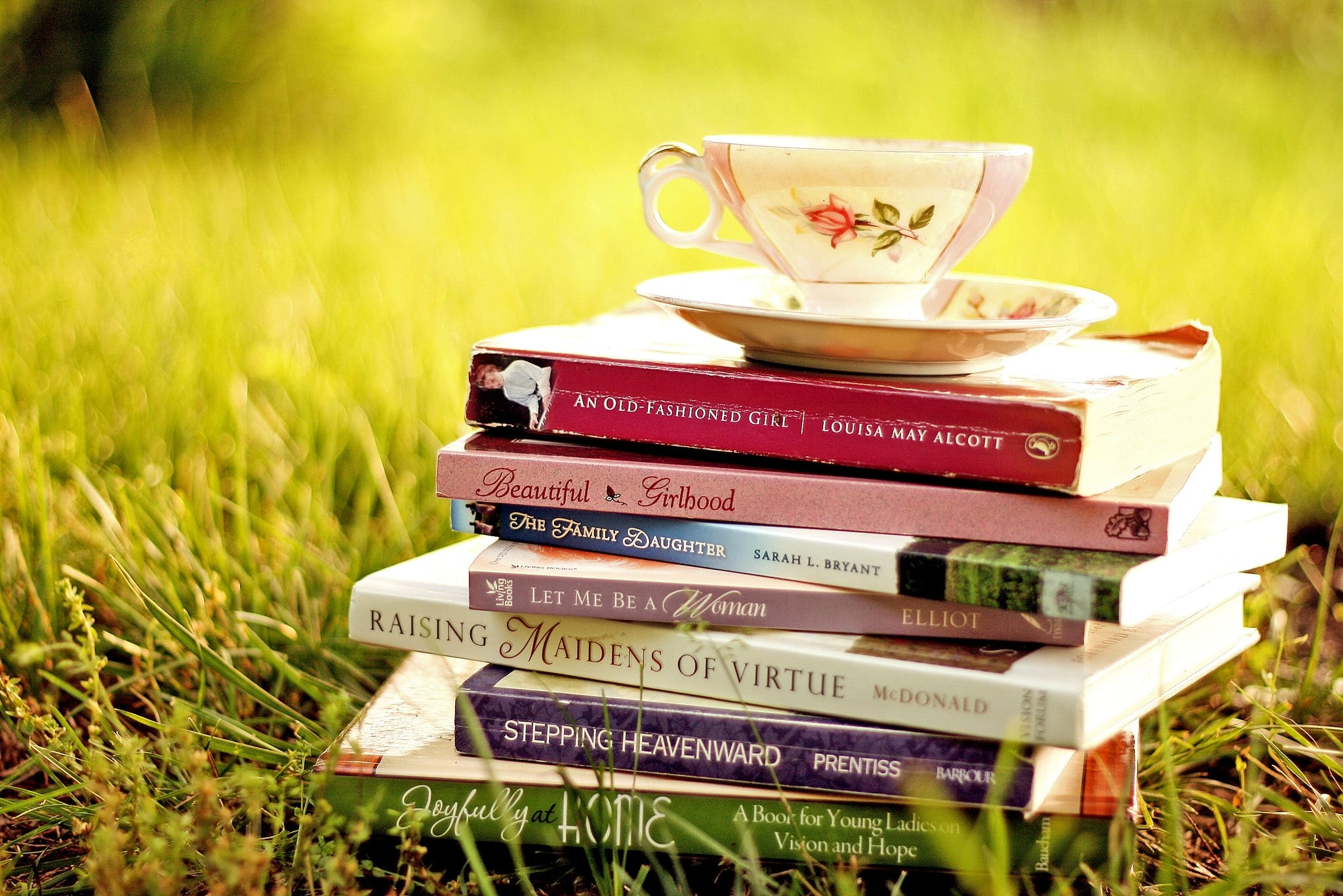 Grass,Book,Cup,Table,Teacup,Publication,Tree,Furniture,Coffee cup,Plant