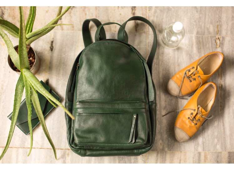 Green,Bag,Footwear,Leather,Backpack,Handbag,Shoe,Fashion accessory,Coin purse,Luggage and bags