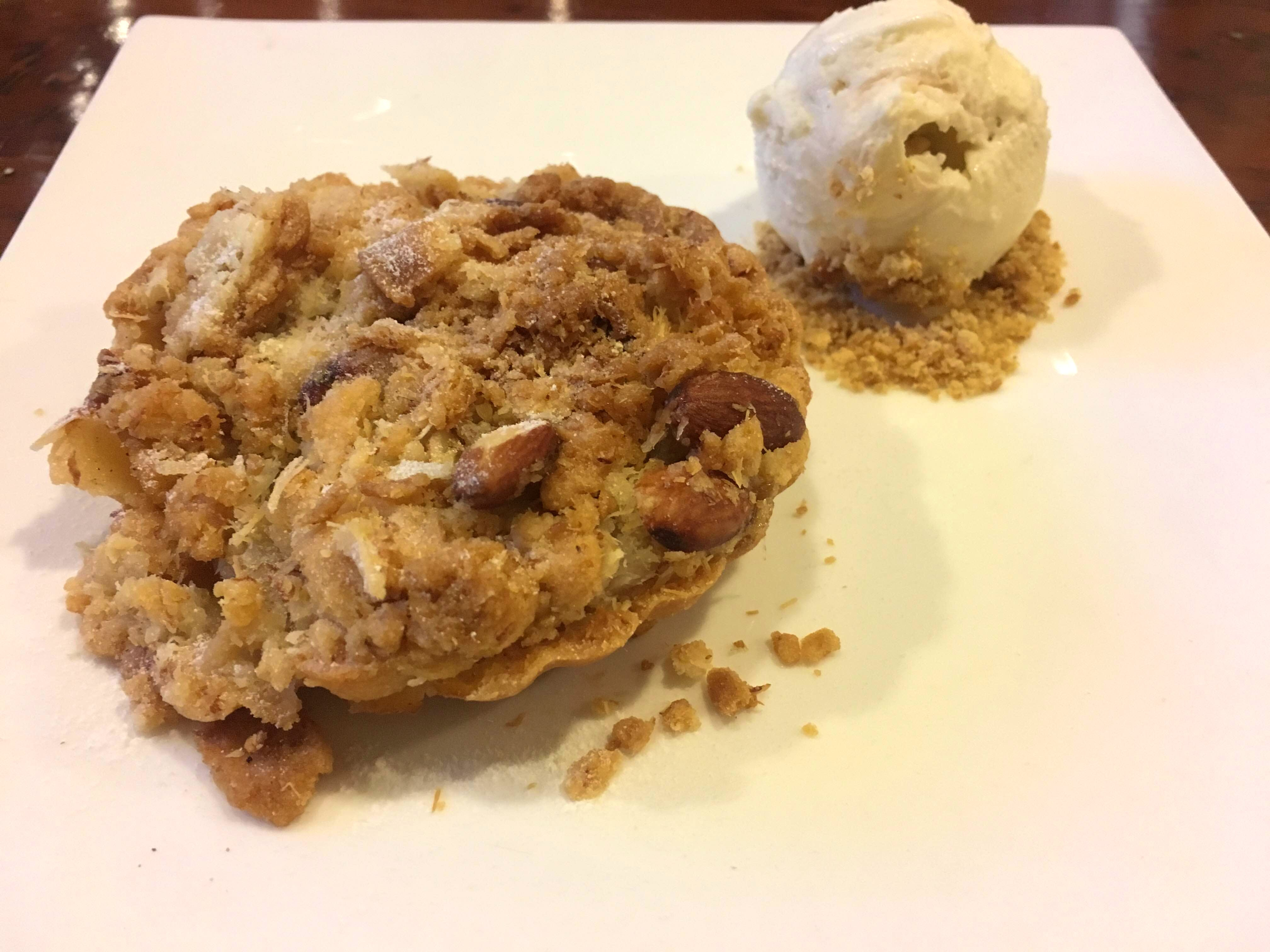 Relish Luscious Apple Crumble Amidst Cosy Decor & Fairy Lights At This Cafe