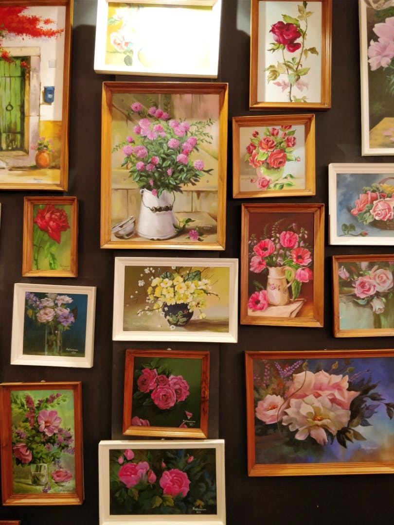 Pink,Flower,Collection,Plant,Picture frame,Room,Visual arts,Still life,Floral design,Art