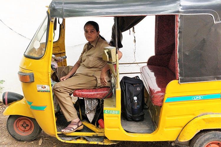 Motor vehicle,Mode of transport,Vehicle,Transport,Rickshaw,Yellow,Car,Commercial vehicle