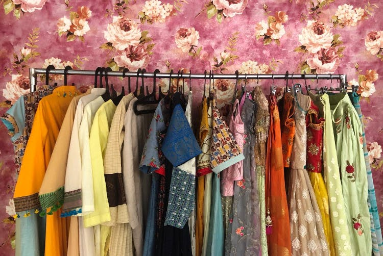 Boutique,Clothing,Clothes hanger,Room,Textile,Dress,Outlet store,Vintage clothing,Closet,Bazaar