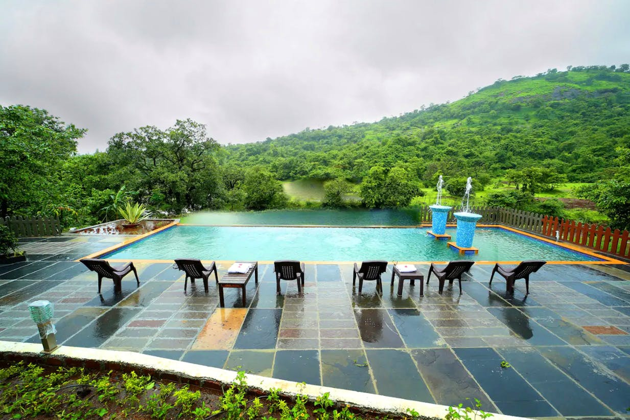 Sky,Leisure,Hill station,Tree,Swimming pool,Architecture,Mountain,Cloud,Tourism,River