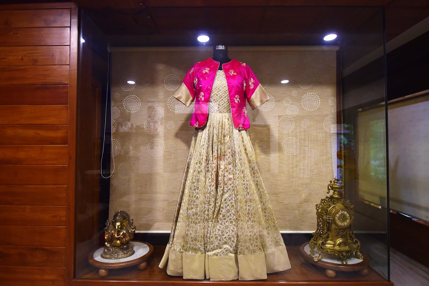 Clothing,Dress,Fashion,Formal wear,Display window,Tradition,Gown,Fashion design,Costume,Temple