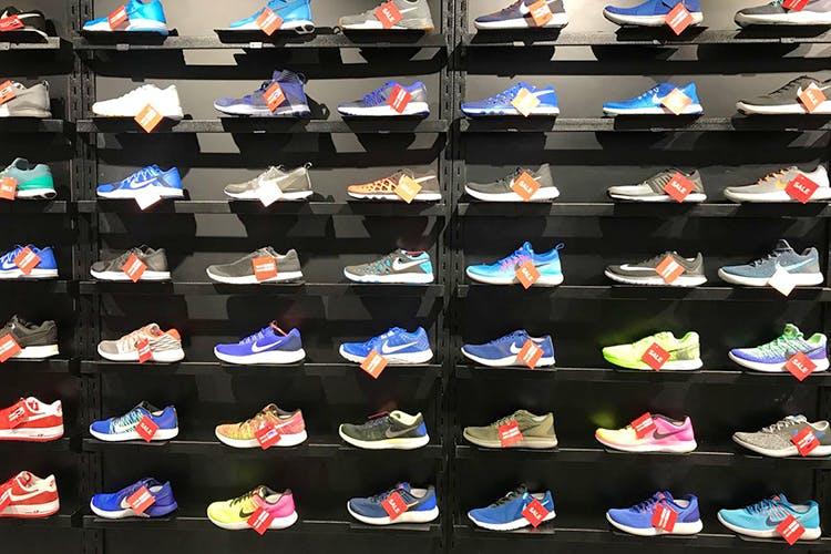 Shoe store,Footwear,Shoe,Headgear,Cap,Athletic shoe,Carmine,Baseball cap,Sneakers,T-shirt