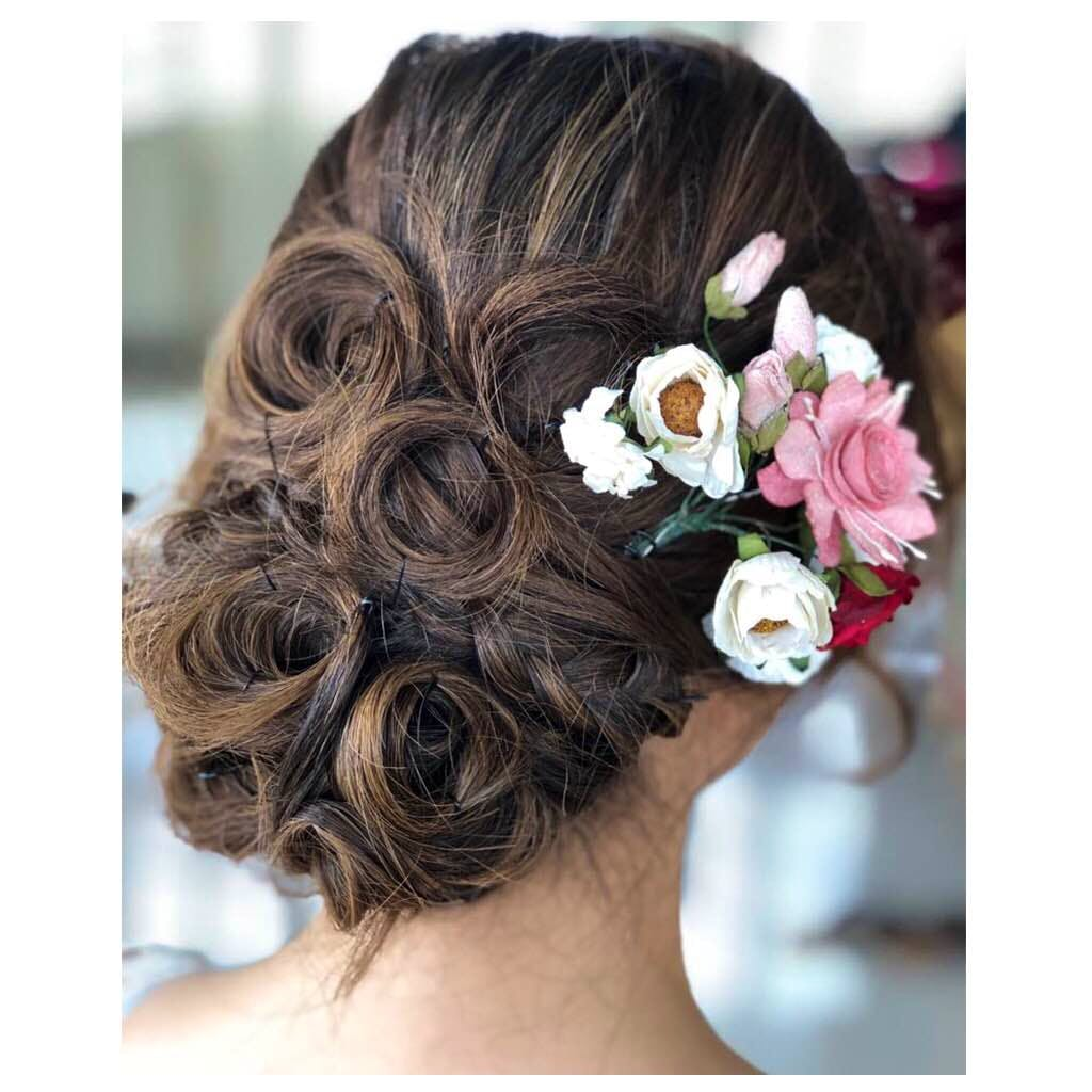 Hair,Hairstyle,Chignon,Beauty,Long hair,Head,Headpiece,Brown hair,Forehead,Bun