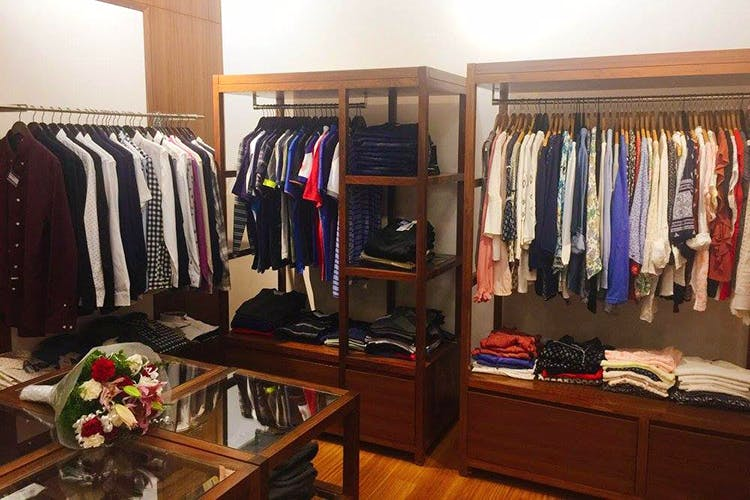 Closet,Room,Wardrobe,Boutique,Clothes hanger,Furniture,Building,Outlet store,Interior design,Retail