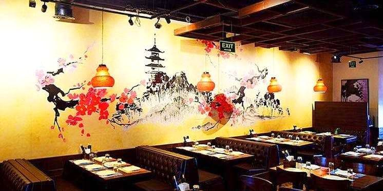 Restaurant,Interior design,Wall,Room,Table,Building,Mural,Art
