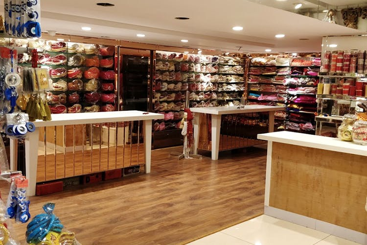 Outlet store,Building,Retail,Product,Footwear,Boutique,Interior design,Eyewear,Shoe,Fashion accessory