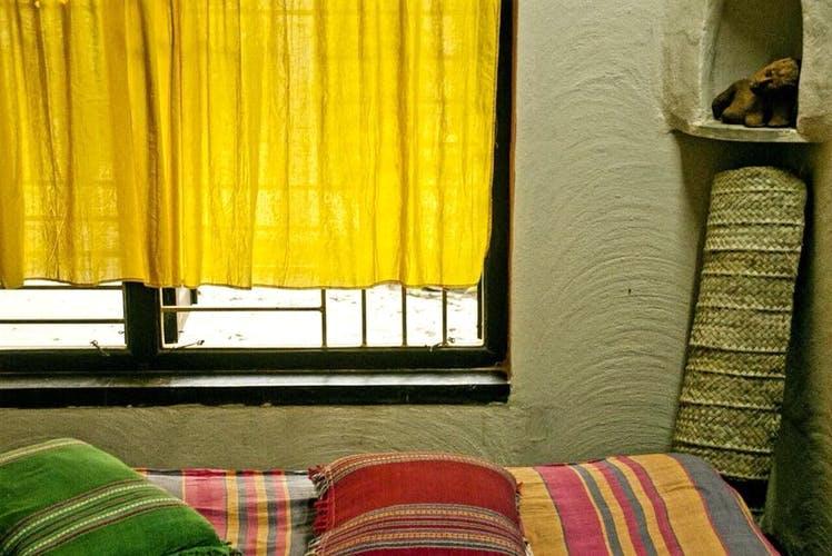 Curtain,Window treatment,Interior design,Yellow,Window covering,Room,Textile,Furniture,Window,Window valance