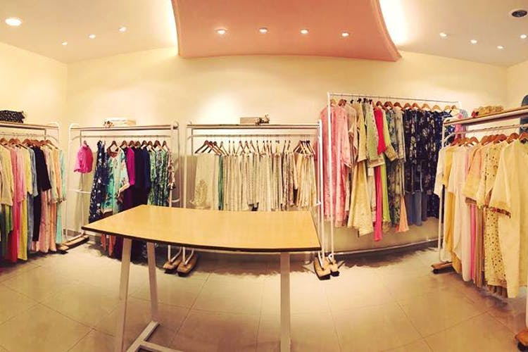 Boutique,Room,Clothing,Clothes hanger,Outlet store,Pink,Fashion,Interior design,Building,Retail