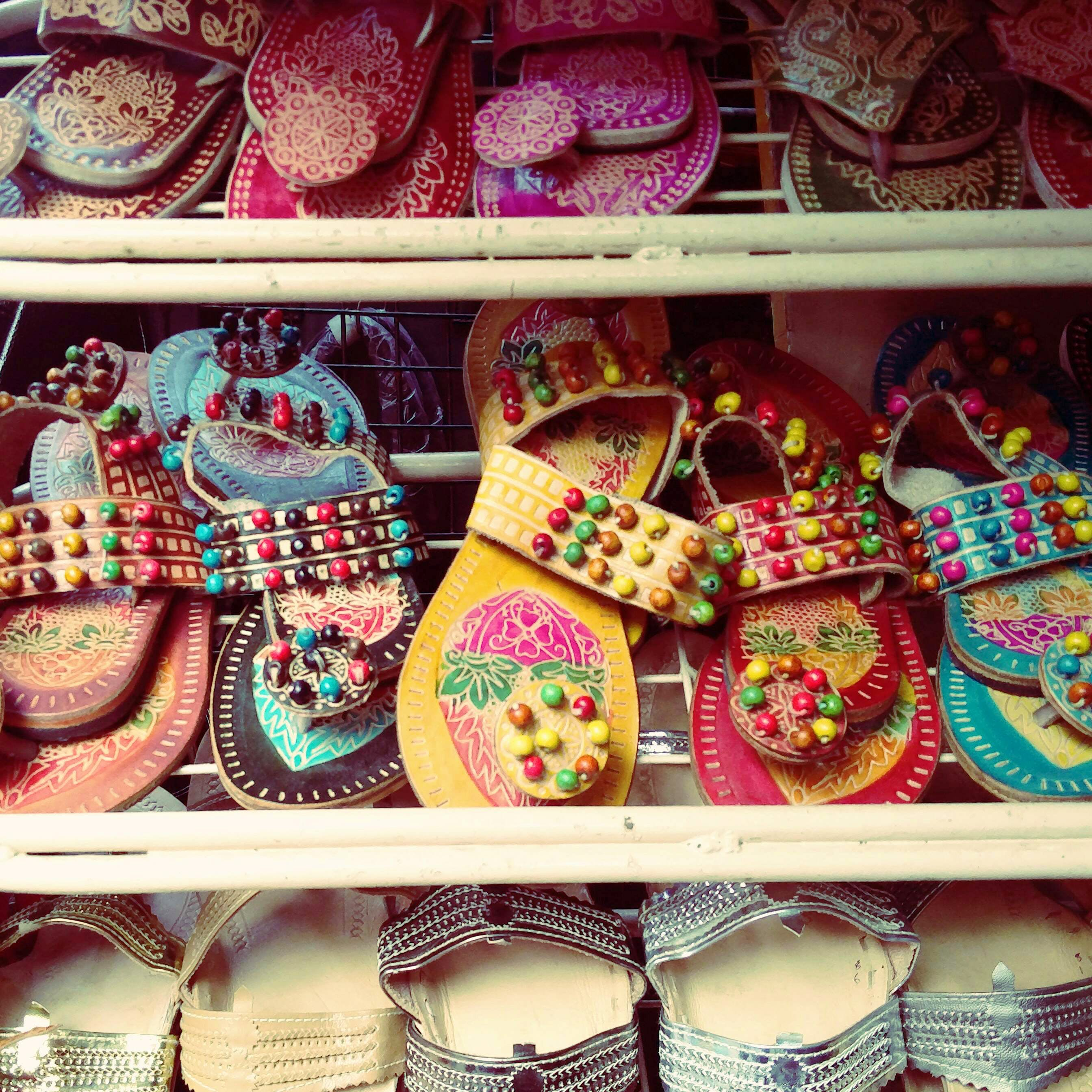 Pink,Footwear,Tradition,Shoe,Textile,Fashion accessory,Souvenir
