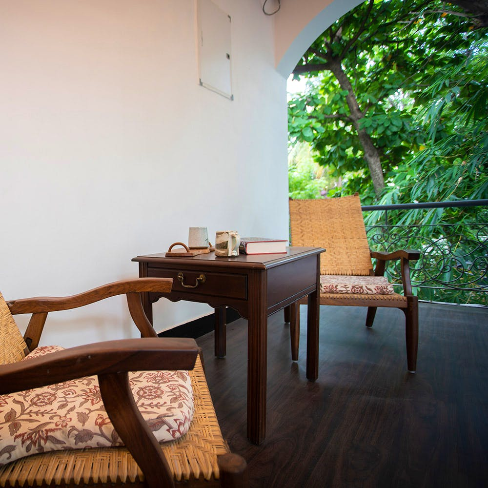 Furniture,Room,Table,Property,Interior design,House,Chair,Floor,Wood,Tree