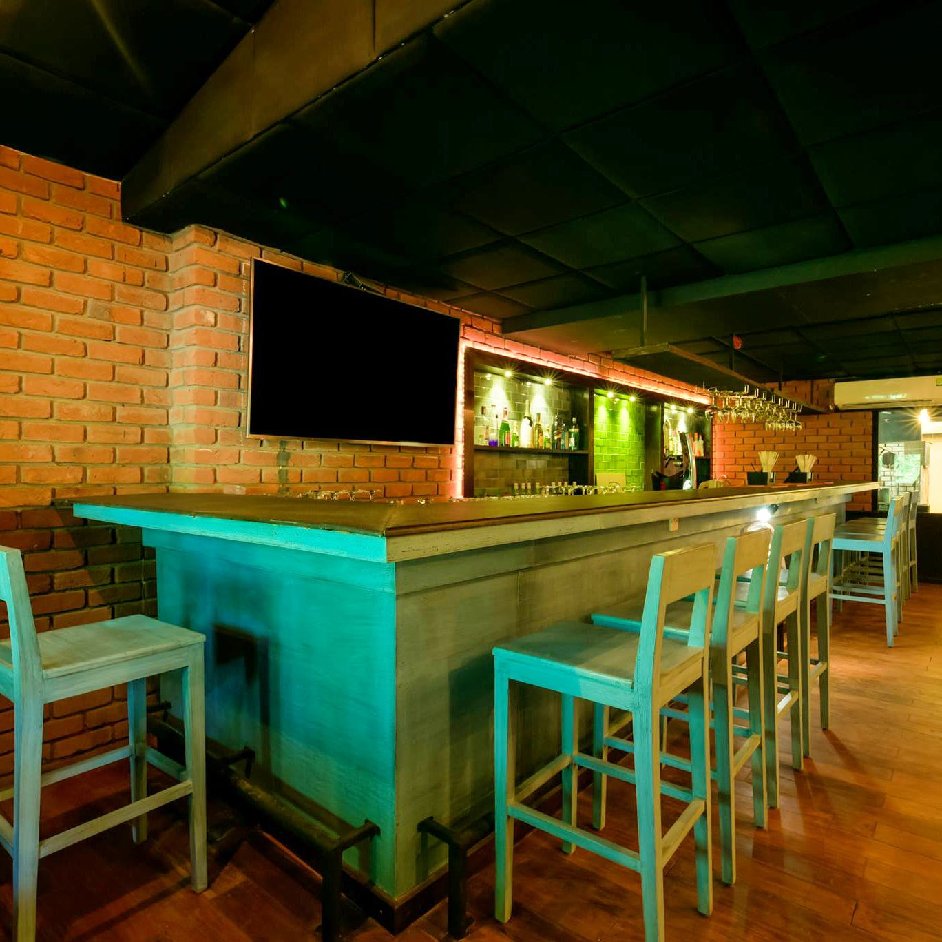 Table,Room,Furniture,Lighting,Bar stool,Building,Bar,Architecture,Interior design,Recreation room