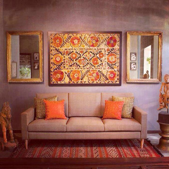 Orange,Wall,Room,Furniture,Living room,Modern art,Couch,Interior design,Painting,Art