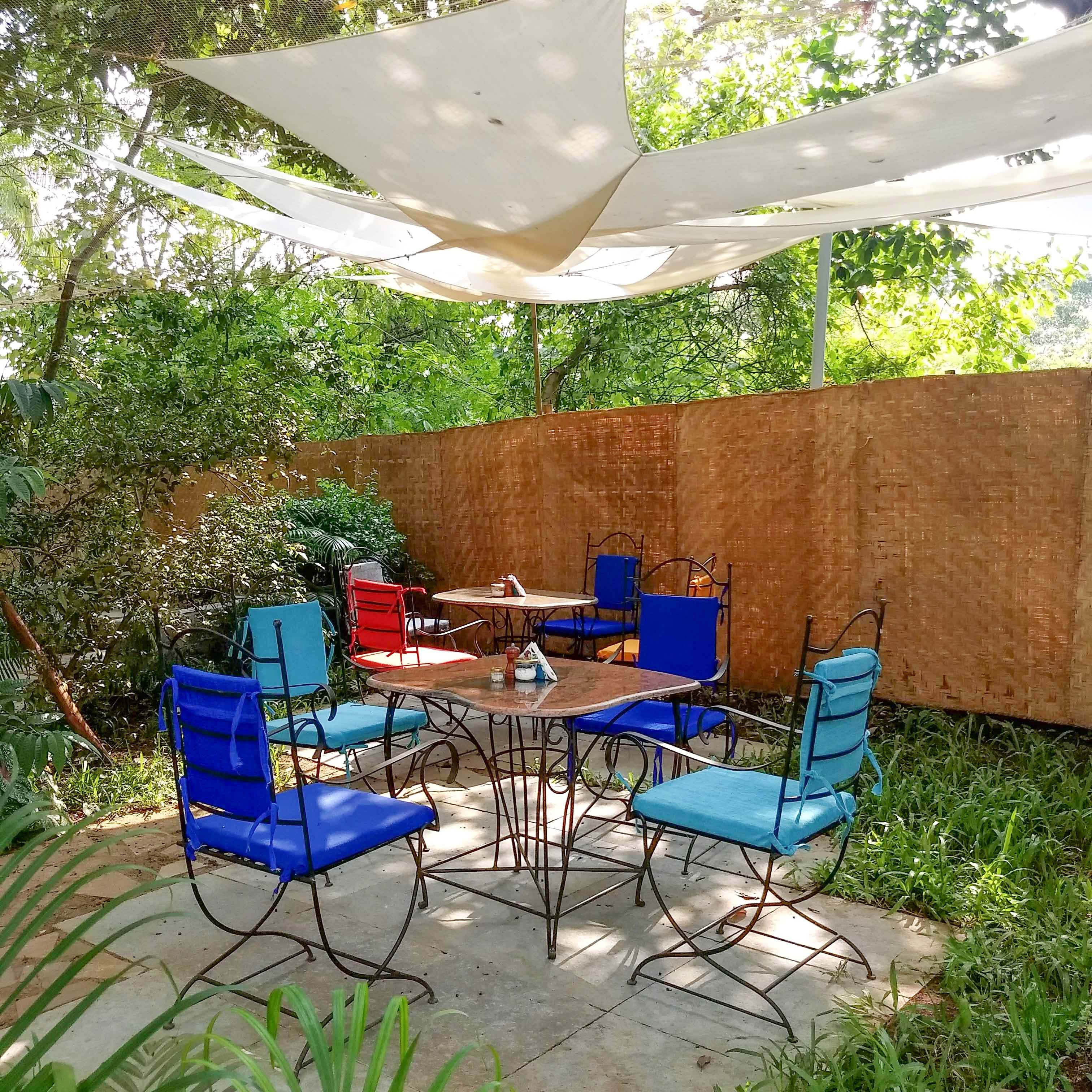 Patio,Backyard,Yard,Property,Shade,Garden,Table,Furniture,Real estate,House