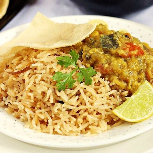 Dish,Food,Cuisine,Ingredient,Biryani,Rice,Kabsa,Spanish rice,Staple food,Recipe