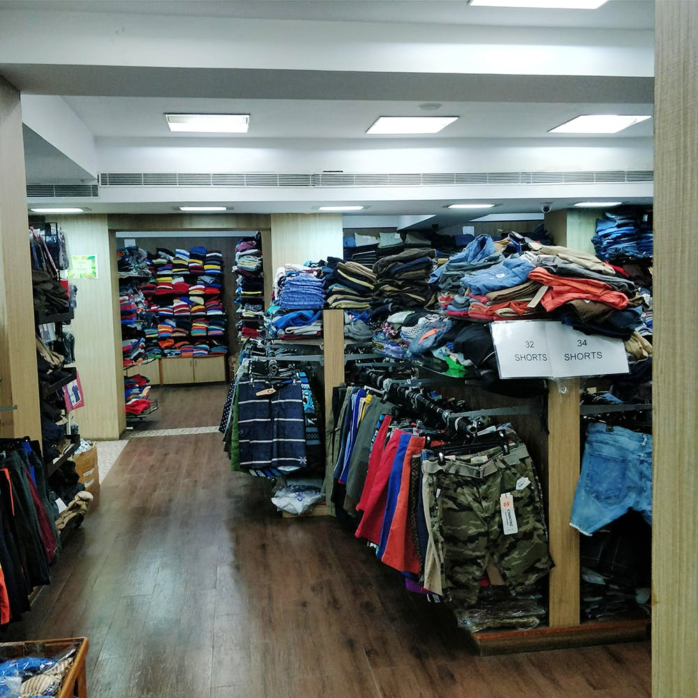 Outlet store,Building,Footwear,Retail,Room,Aisle,Collection,Shoe,Athletic shoe