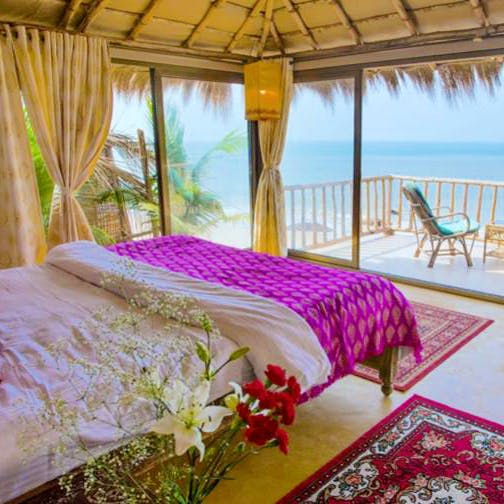 The Best View Ever! This Resort's Huts Overlook The Lagoon & The Beach