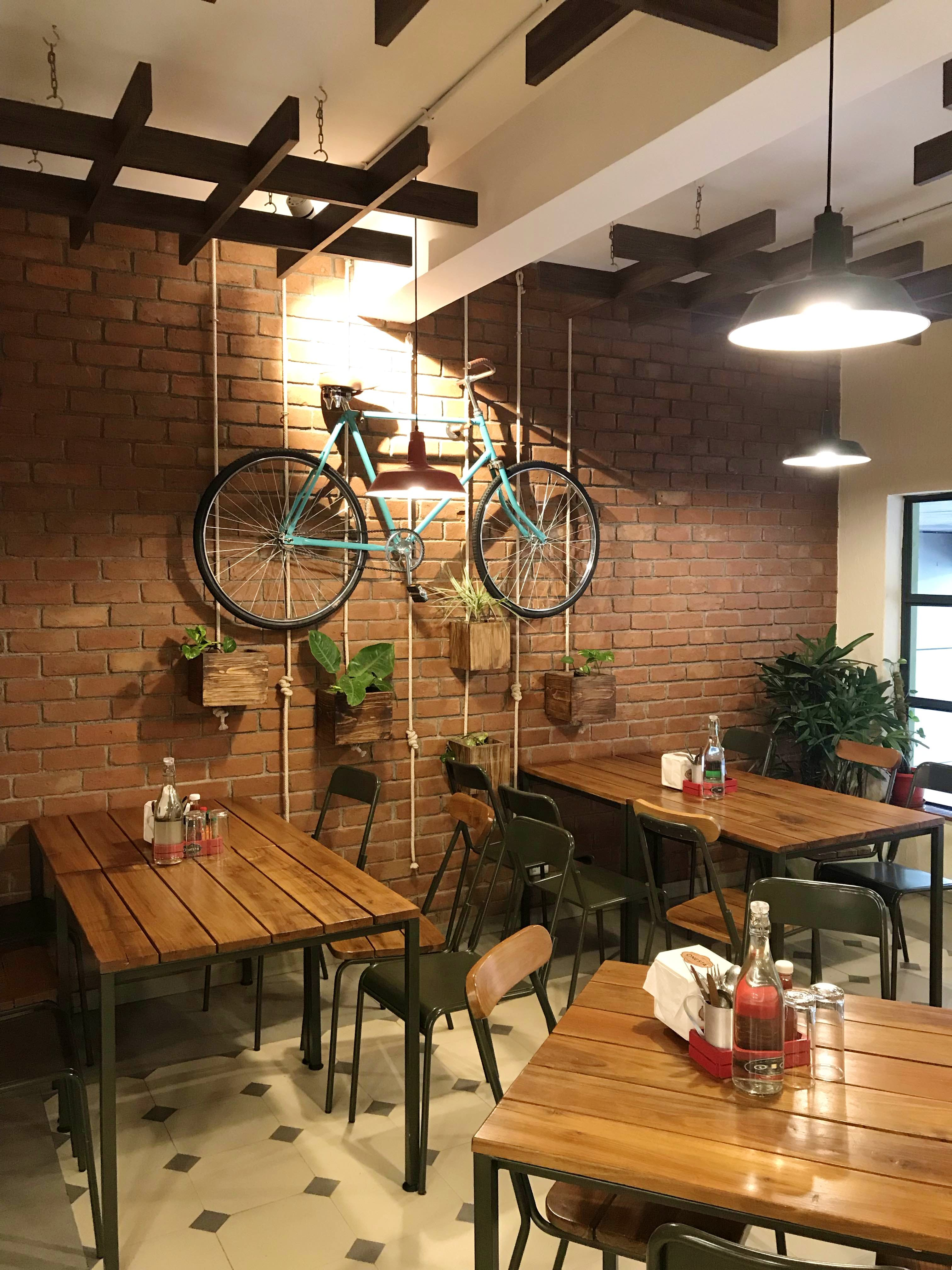 Room,Table,Building,Interior design,Ceiling,Furniture,Restaurant,Café,Bicycle,Bicycle wheel