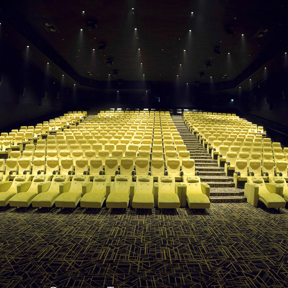 Auditorium,Concert hall,Theatre,Performing arts center,Yellow,Stage,heater,Architecture,Convention center,Chair