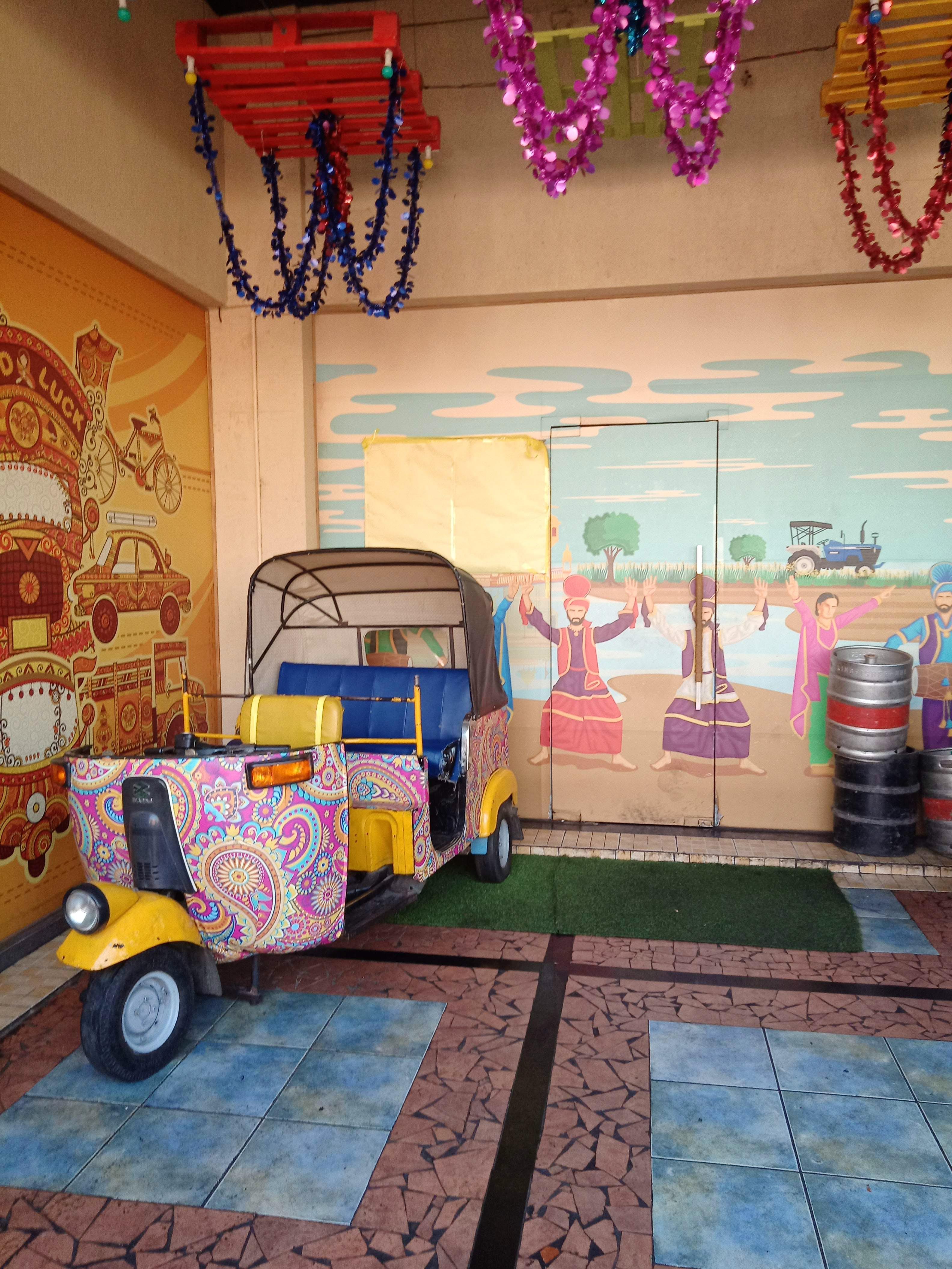 Mode of transport,Yellow,Transport,Wall,Vehicle,Automotive design,Car,Vacation,Art,Visual arts