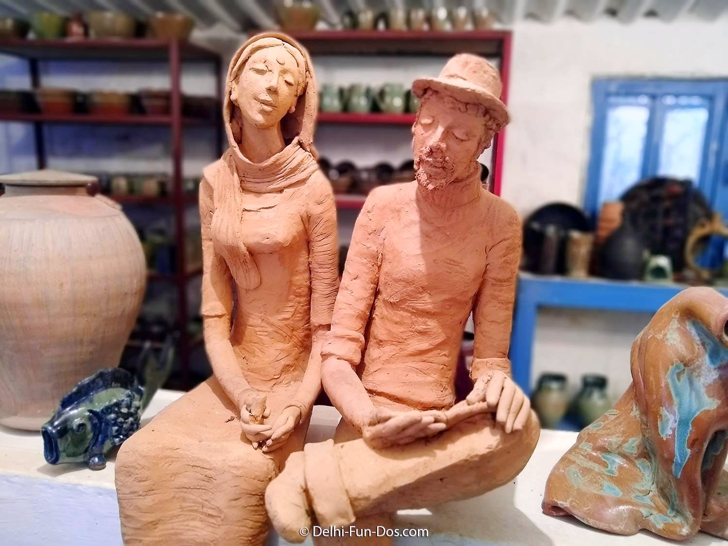 Sculpture,Figurine,Art,Carving,Sculptor,Nativity scene,Chainsaw carving,Statue,Classical sculpture,Ceramic