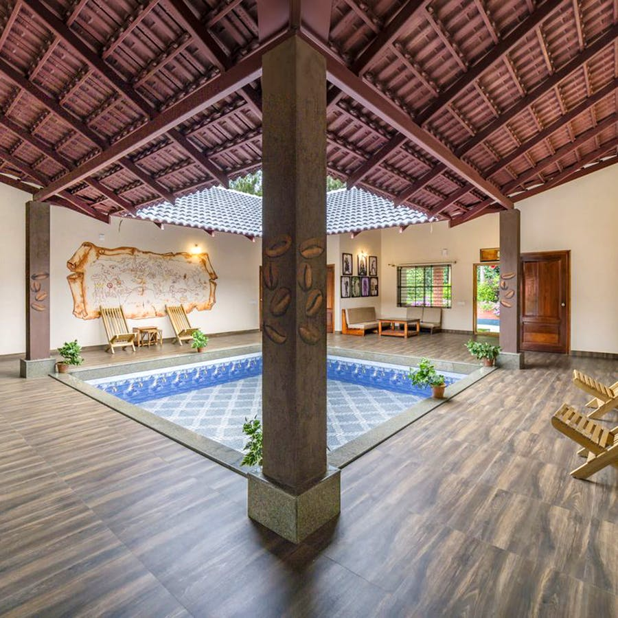 Building,Ceiling,Property,Interior design,House,Room,Swimming pool,Architecture,Real estate,Tree