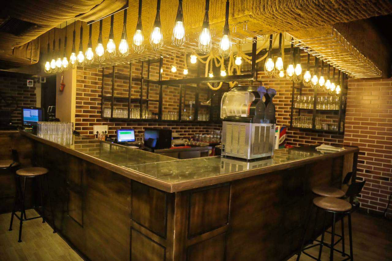 Lighting,Bar,Building,Room,Interior design,Countertop,Tavern,Architecture,Pub,Ceiling