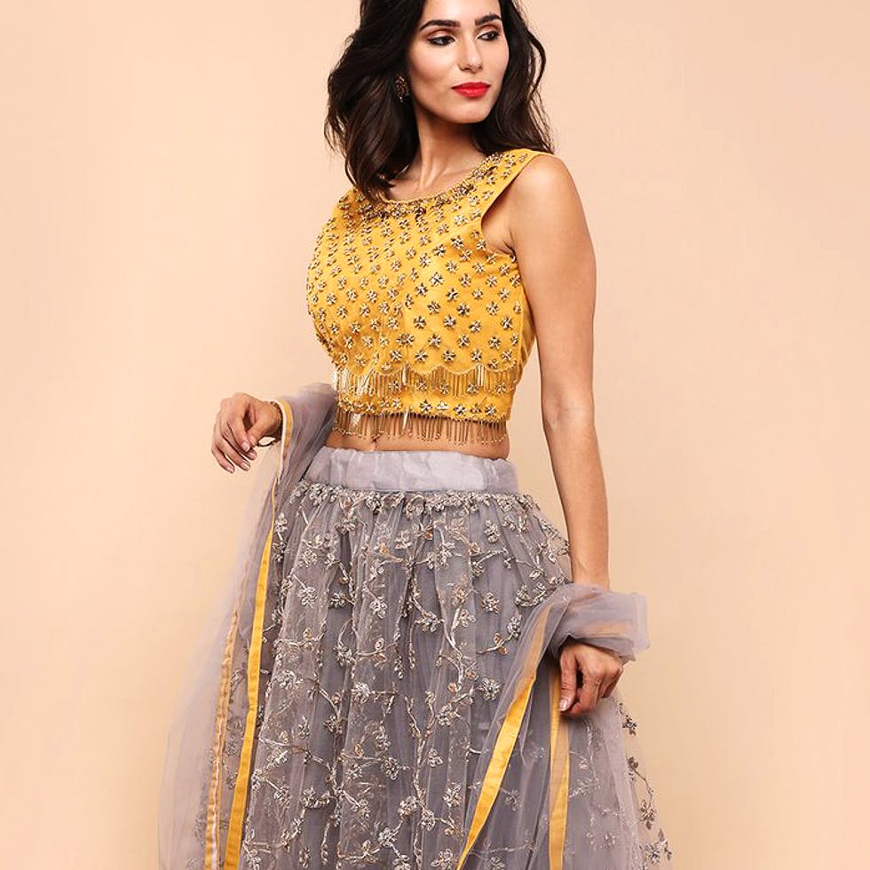 Clothing,Fashion model,Waist,Dress,Yellow,Photo shoot,Fashion,Neck,Formal wear,Crop top