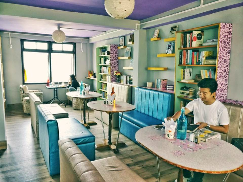 Room,Turquoise,Blue,Green,Interior design,Building,Yellow,Furniture,Table,Dining room