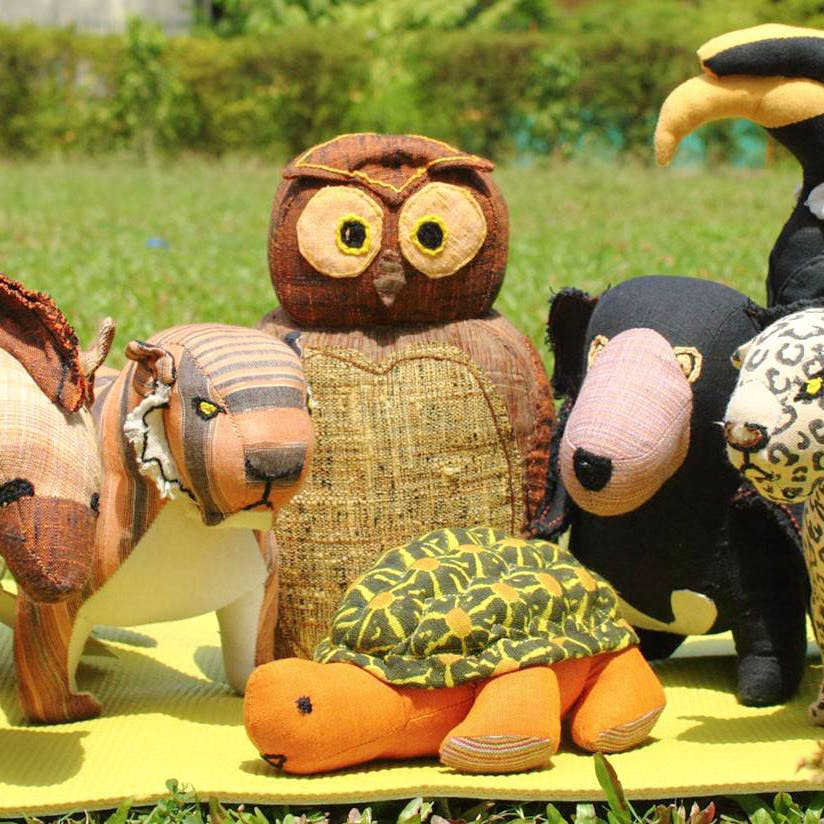 Toy,Stuffed toy,Chainsaw carving,Plush,Animation,Animal figure,Fawn,Sculpture,Art