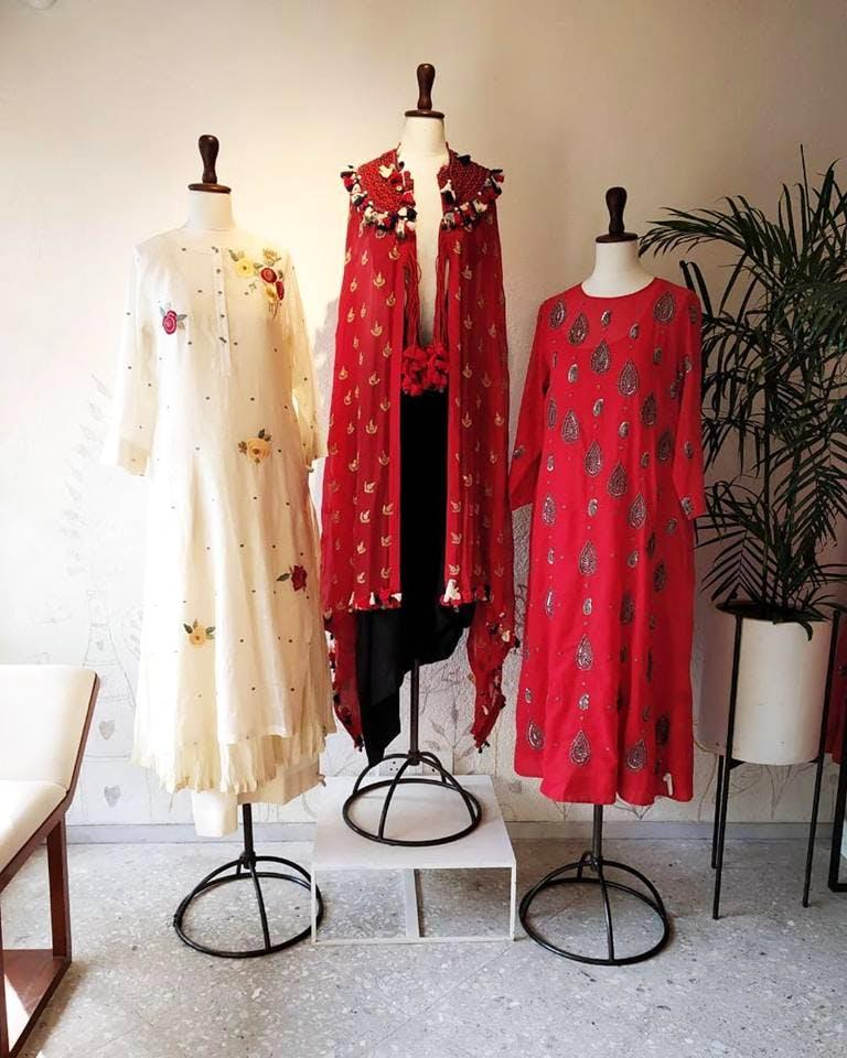 Clothing,Boutique,Dress,Formal wear,Fashion,Mannequin,Textile,Fashion design,Outerwear,Room