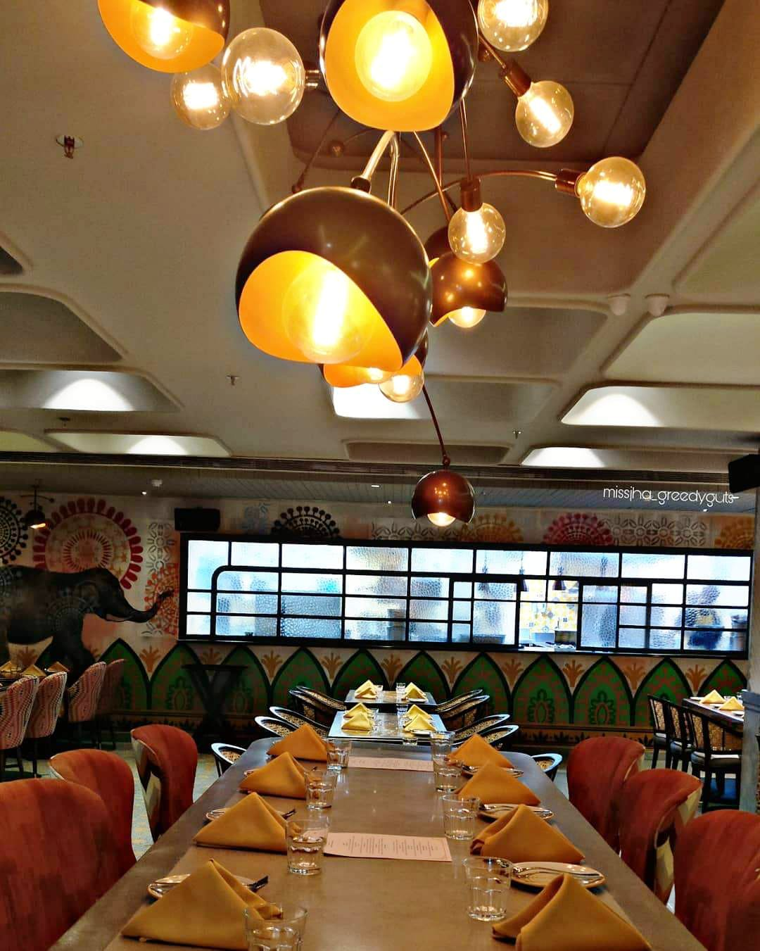 Restaurant,Lighting,Ceiling,Interior design,Building,Room,Function hall,Architecture,Table