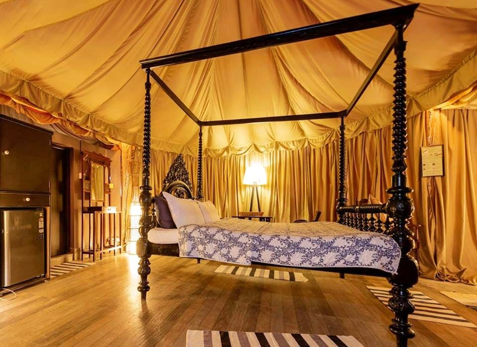 Canopy bed,Bed,Furniture,Bedroom,Room,four-poster,Property,Interior design,Building,Lighting