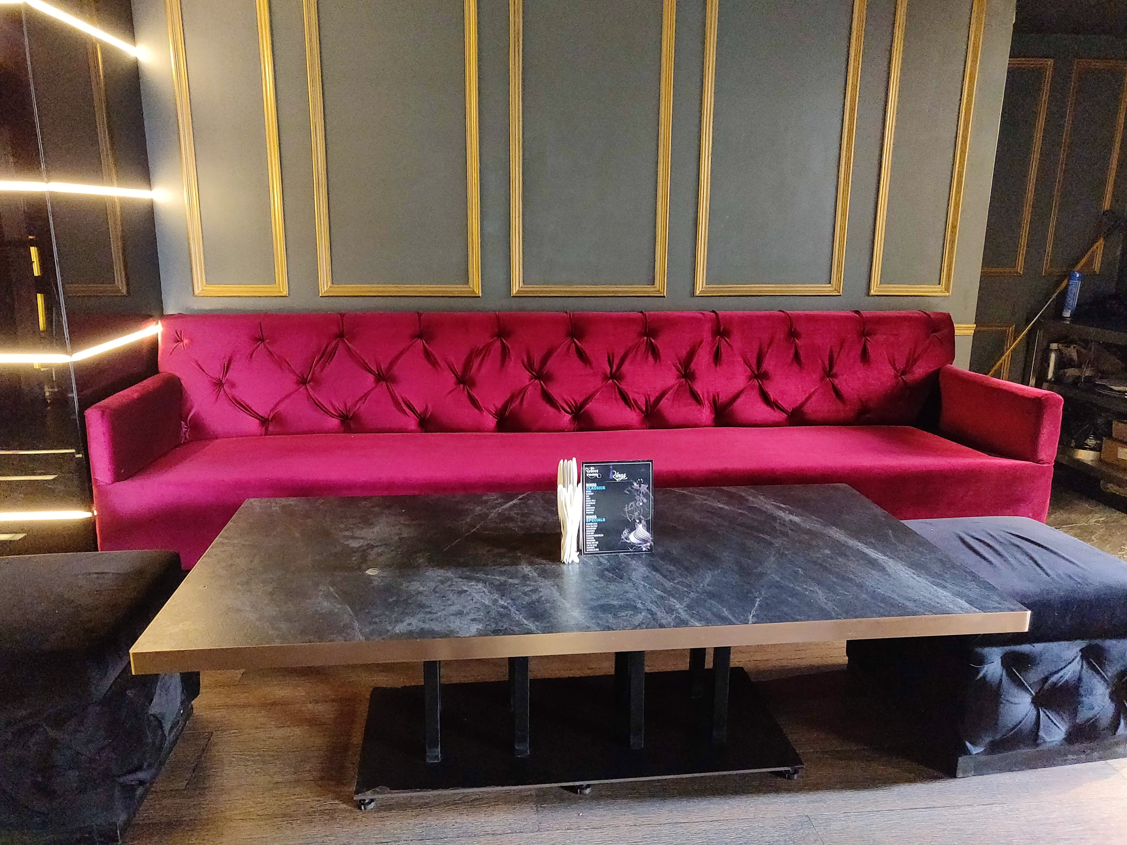 Furniture,Couch,Room,Red,Pink,Table,Living room,Interior design,Purple,Coffee table