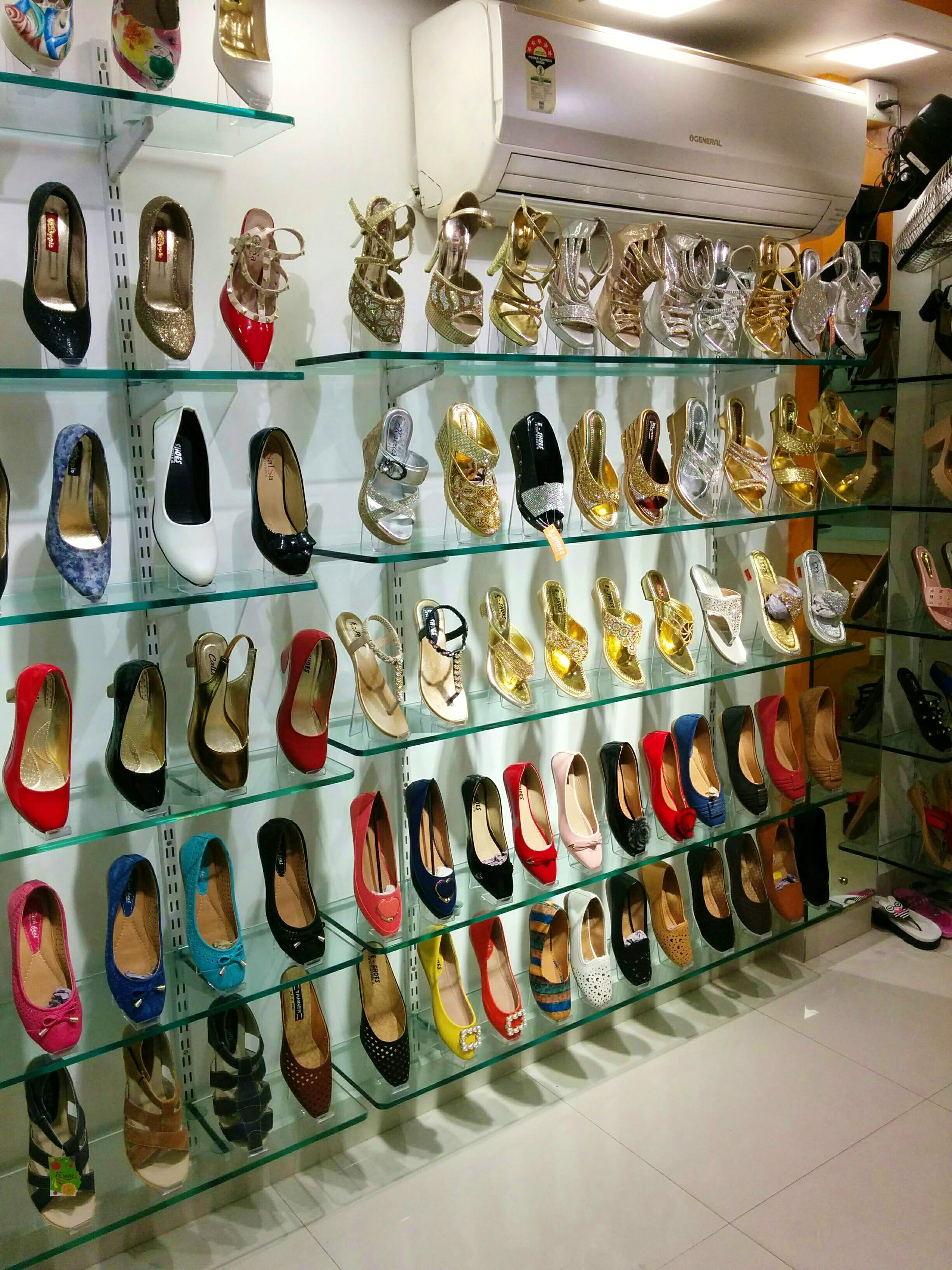 Footwear,Collection,Shoe store,Shoe,Display case,Outlet store,Room,Boutique,Fashion accessory,Athletic shoe