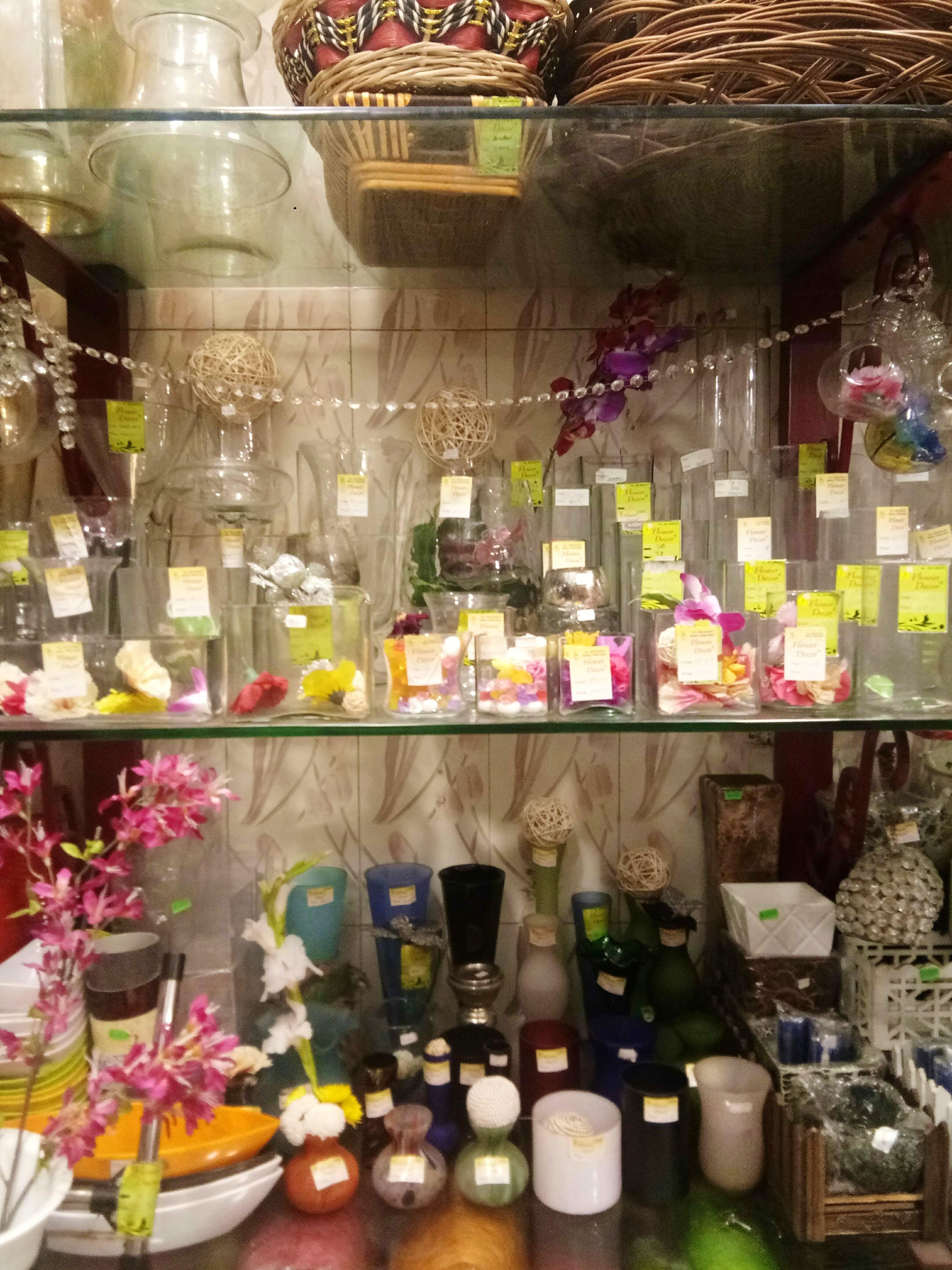 Glass bottle,Bottle,Alcohol,Floristry,Distilled beverage,Liqueur,Plant,Flower,Drink,Glass