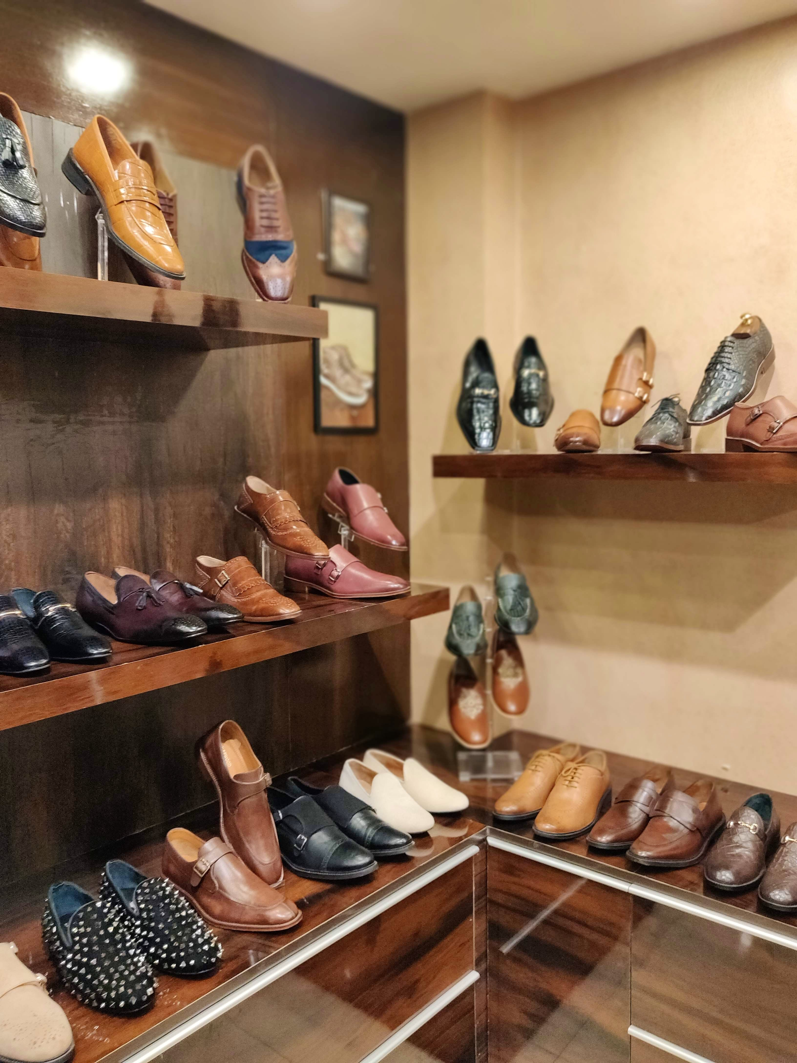Shoe store,Shelf,Footwear,Room,Shoe,Collection,Display case,Interior design,Shelving,Building