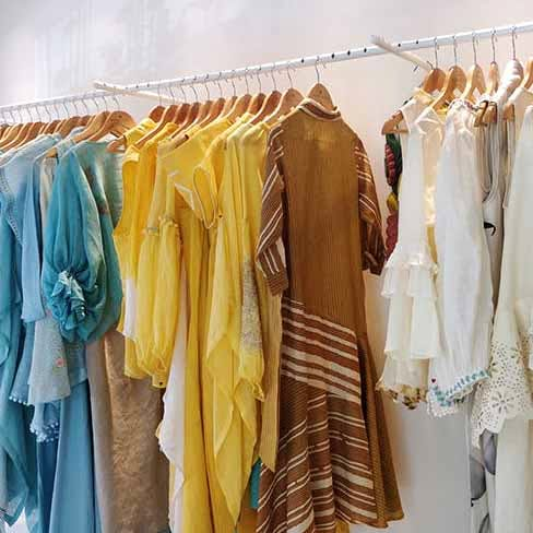 Clothes hanger,Clothing,Yellow,Room,Boutique,Closet,Dress,Furniture,Outerwear,Textile