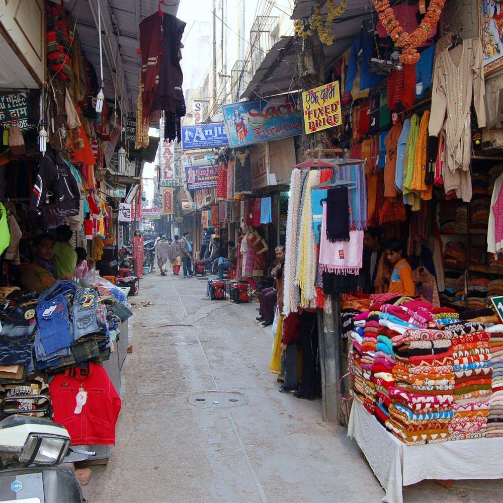 Bazaar,Market,Marketplace,Selling,Public space,Street,Human settlement,Town,City,Shopping
