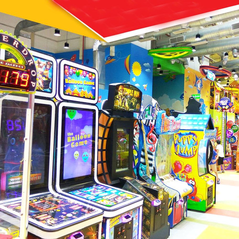 Games,Arcade game,Video game arcade cabinet,Recreation,Technology,Electronic device,Machine,Arcade,Room,Building