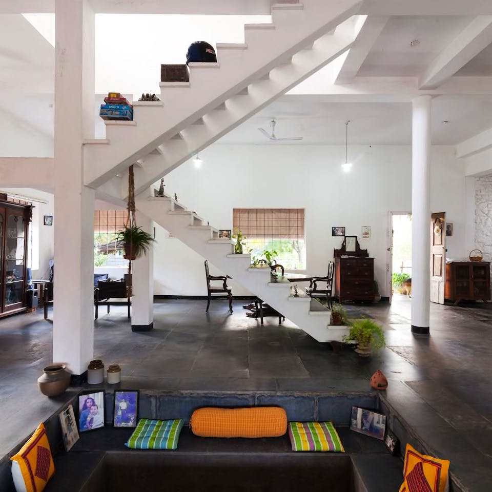 Interior design,Living room,Building,Ceiling,Room,Property,Architecture,House,Floor,Loft