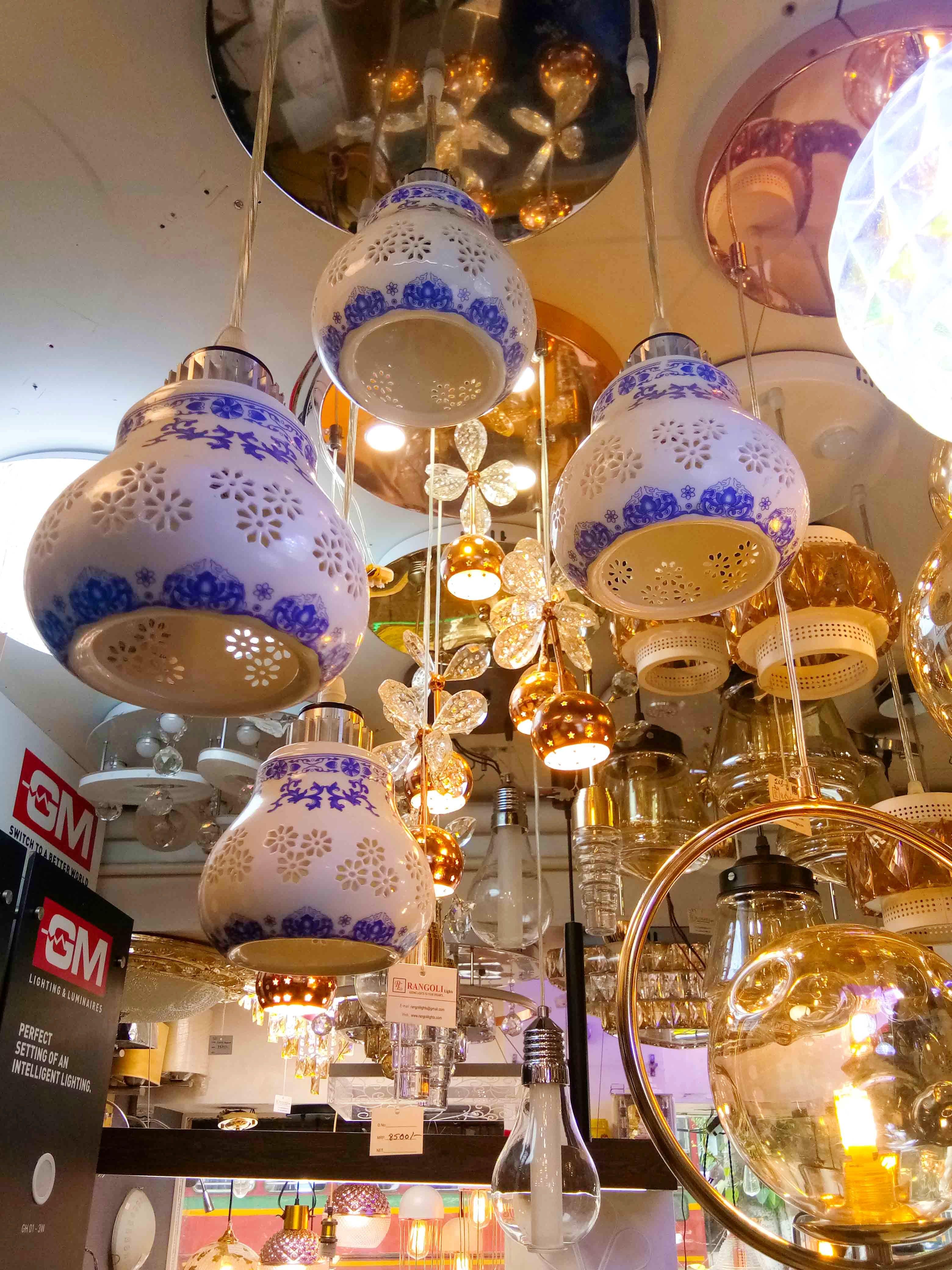 Lighting,Lighting accessory,Light fixture,Chandelier,City,Interior design,Ceiling,Market,Lamp,Porcelain